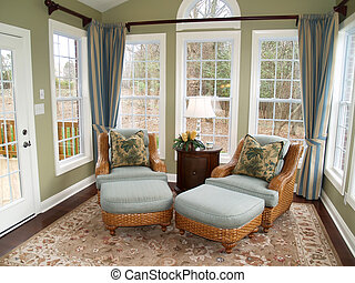 Bright Sunroom - Two comfortable rattan or wicker chairs in...