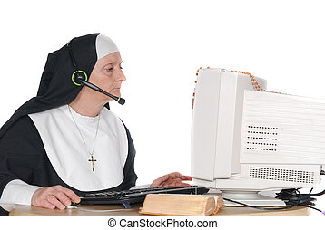 religious hot line - Middle aged nun, sister on computer,...