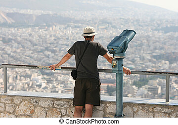 view point - man tourist watching the view of athens from...