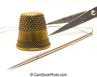 Scissors, thimble and a needle - An isolated photo of...