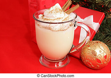 Christmas Eggnog & Copyspace - A frothy mug of eggnog under...
