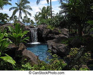 Tropical lagoon and waterfall at Hawaiian resort hotel