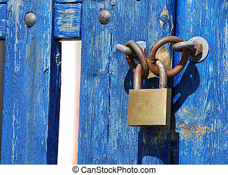 Blue Gate Lock - Padlock on a blue wooden gate in Greece