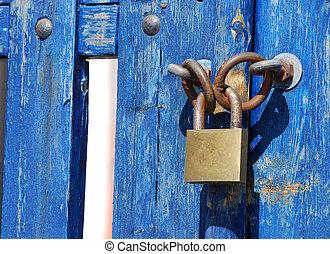 Blue Gate Lock - Padlock on a blue wooden gate in Greece
