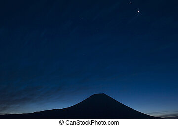 Blue Fuji III - Silhouette of Mt. Fuji against a dark blue...