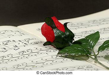 Sheetmusic - Photo of Sheetmusic With Red Fabric Rose -...
