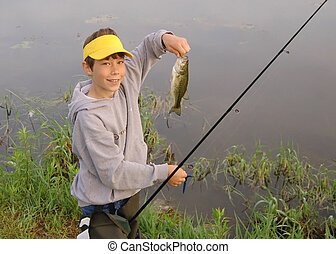 Kids Fishing Catch - A boy showing off his first large mouth...