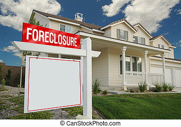 Blank Foreclosure Sign and House with dramatic sky...