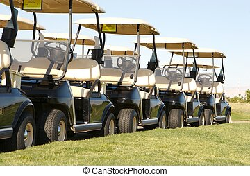 parked golf carts - image of parked golf carts in a row on a...