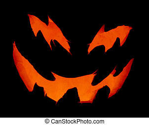Scary Pumpkin Up Close - A close up of a pumpkin carved with...