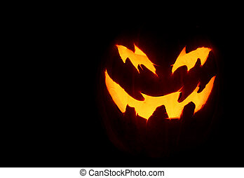 Scary Pumpkin - A close up of a pumpkin carved with for...