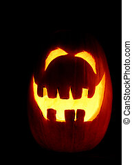 Smiling Pumpkin - A smiling pumpkin glowing on halloween...