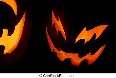 Halloween Night - A closeup shot of two carved pumpkins on...