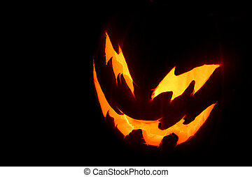Spooky Pumpkin Face - A spooky pumpkin face glowing on...