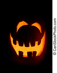 Smiling Jack-o-Lantern - A single smiling pumpkin glowing on...