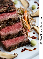 Seared Japanese Beef on plate with garnish