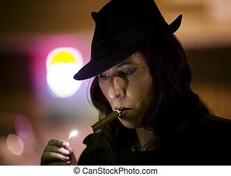 Woman Lighting Cigar - Woman in a fedora lighting a cigar...