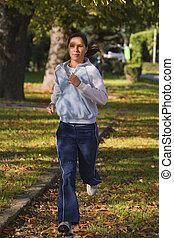 Running woman - Young woman running in an autumn parkShot...