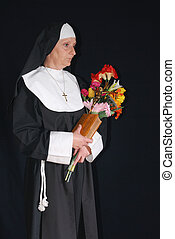 Devout nun - Middle aged devout nun in deep thoughts,...
