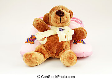 Teddy and baby shoes