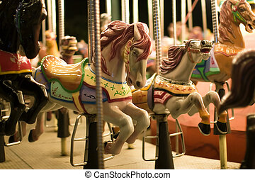 carousel at park - night shot of carousel at amusement park