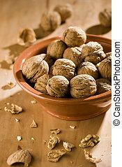walnut - dried walnuts in a bowl close up shoot