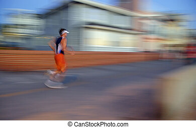 Jogger in Motion - An intentional slow-shutter blur, gives...