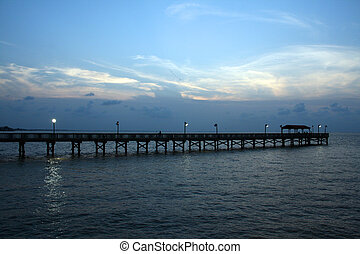 Long Fishing Pier - A long fishing pier at sunset