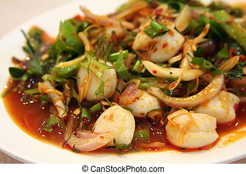 Thai salad - Thai seafood and vegetable salad white plate