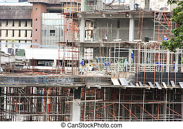 Construction site - Urban construction site with workmen in...