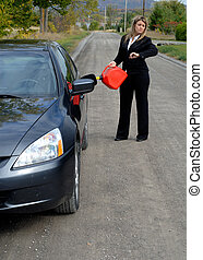 Automobile Breakdown - Young Businesswoman Filling Her Car...
