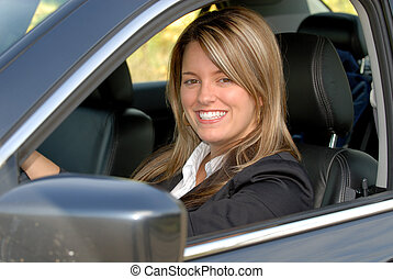 Driving - Attractive Smiling Blond Businesswoman Driving Her...