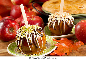 Caramel apples topped with chocolate and nuts