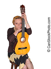 Woman with guitar - Middle aged attractive woman, singer...