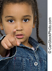 What About You - A beautiful mixed race girl points into the...