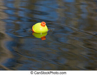 Fishing Bobber - A fishing bobber waiting for a fish to take...