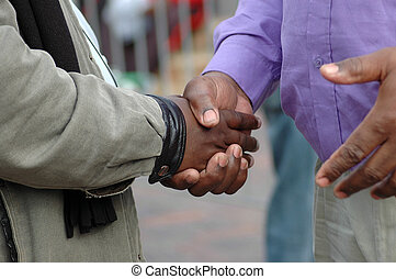 African hands shaking - Two African American men shaking...