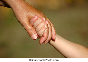 Holding hands - An elderly Caucasian white female hand of a...
