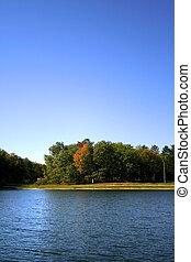 Autumn Scene - colourful autumn trees near lakeside in...
