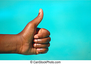 Thumb up - A black hand of an African American woman with...