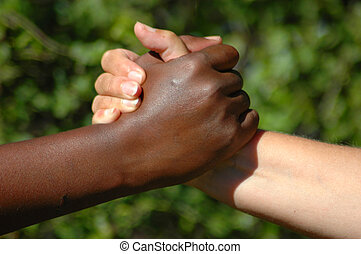 Perfect team hands - A black hand of an African American...