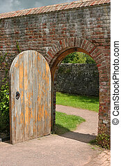Ancient Doorway - Old open arched wooden door set into an...