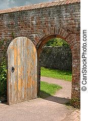 Ancient Doorway - Old open arched wooden door set into an...