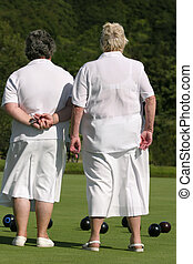 Ladies Who Bowl - Two elderly ladies dressed in white...