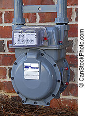 Utility Meter - New utility meter installed outside a brick...