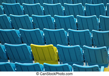 Yellow Seat - Yellow among blue seats