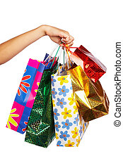 Boxing day - woman hand with shopping bags. Isolated over...