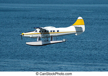 Touchdown - Seaplane about to land on water