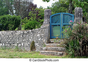 Blue Gate - A few steps lead up to a wooden garden gate...