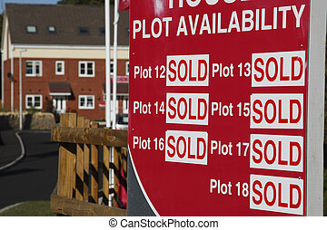 plots all sold sign with the house development in the...